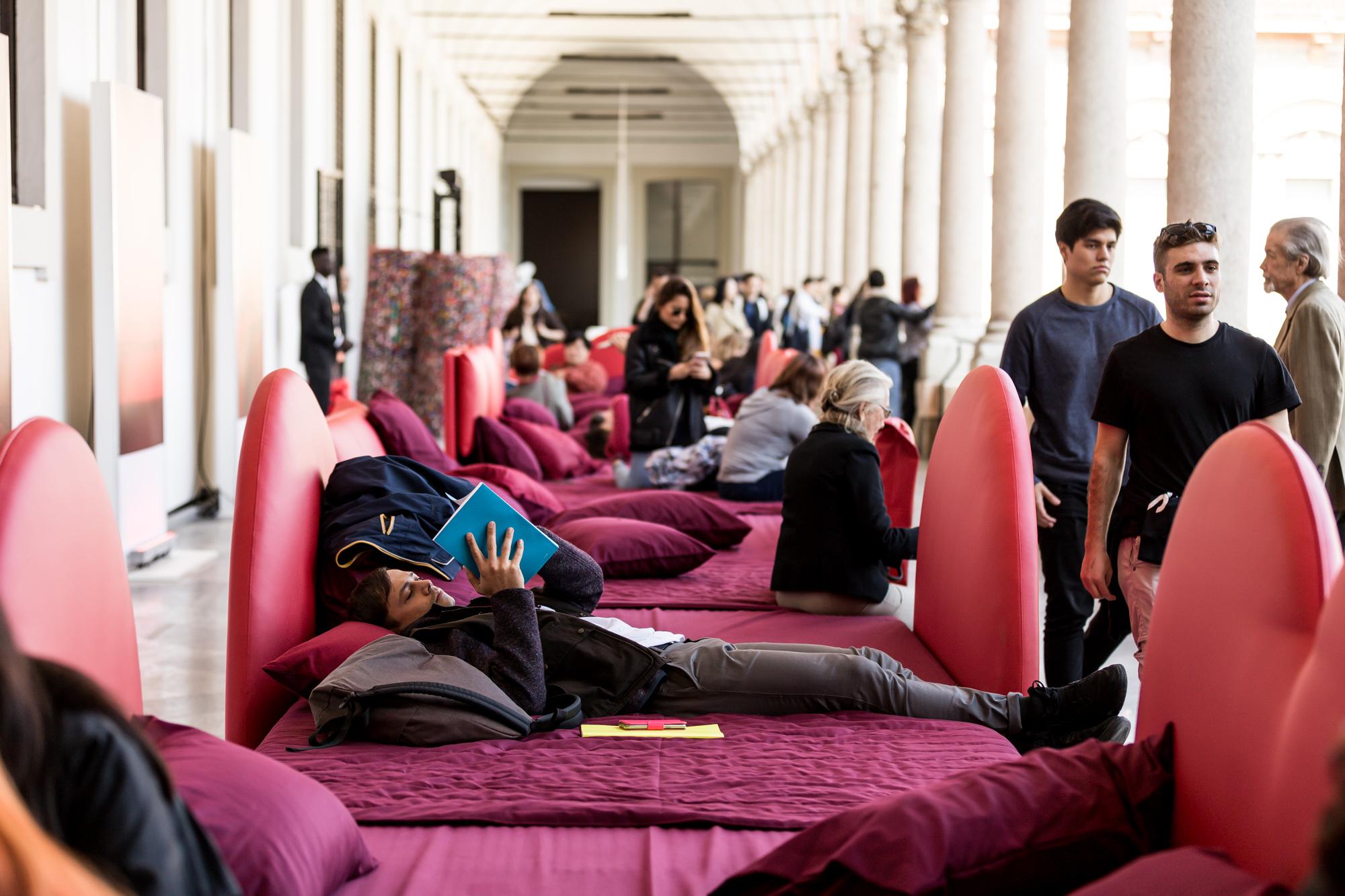 Man reading during Salone del mobile - Work of Fabio Novembre